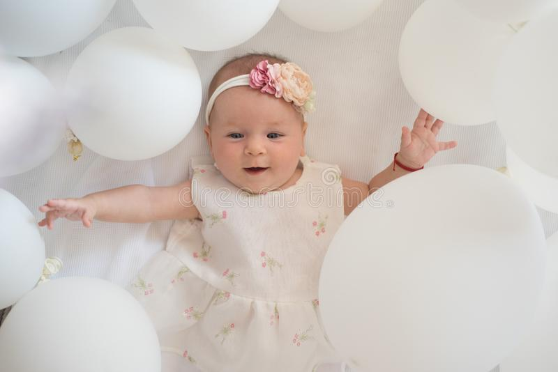 I love my baby. Family. Child care. Childrens day. Small girl. Happy birthday. Childhood happiness. Portrait of happy. Little child in white balloons. Sweet stock images