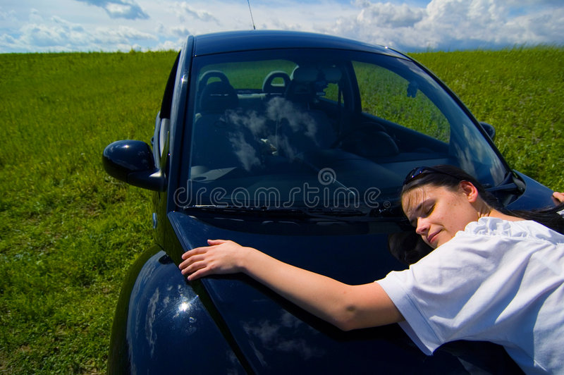 I Love My Car. A woman hugging her car