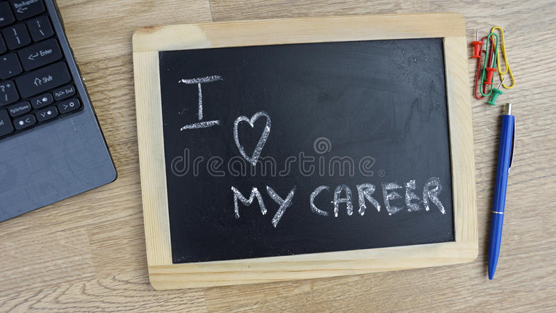 I love my career. Written on a chalkboard at the office stock photography