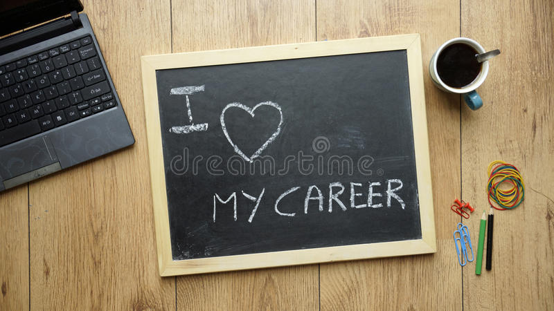 I love my career. Written on a chalkboard at the office stock photos