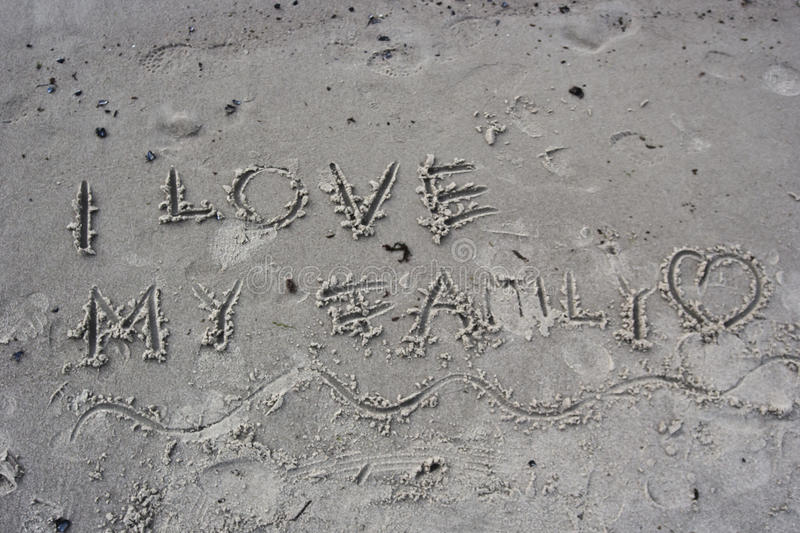 I love my family. Written in the sand stock photo
