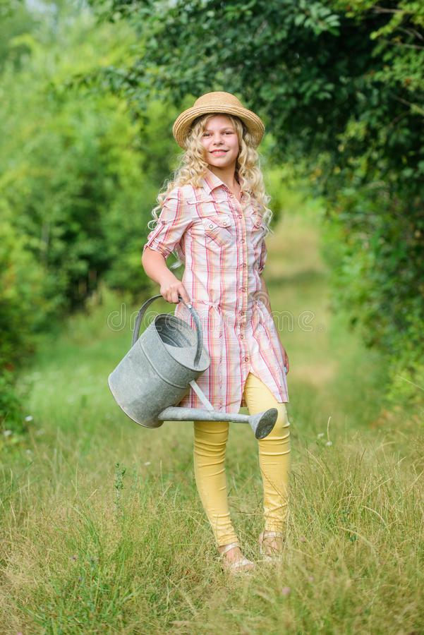I love my job. summer season. small girl with watering can. earth day. environment ecology. nature protection. little. Girl farmer care plants. farming and royalty free stock images