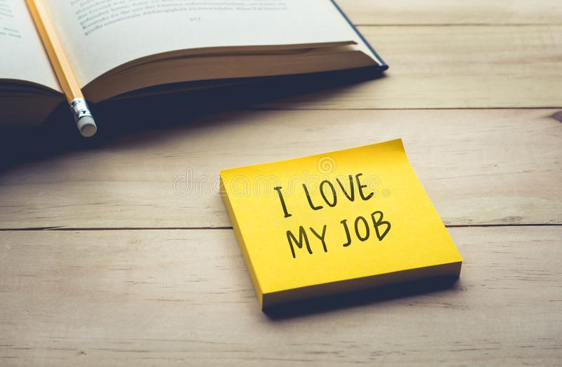 I love my job text with notepaper,notepad stock images
