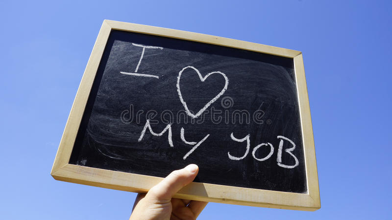 I love my job. Written on a chalkboard in the sun royalty free stock photos