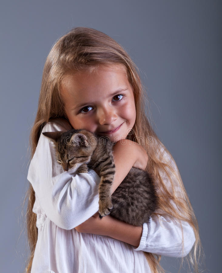 I love my kitten. Little girl holding her new pet stock photo