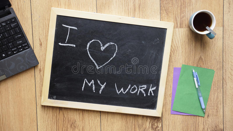 I love my work. Written on a chalkboard at the office royalty free stock image