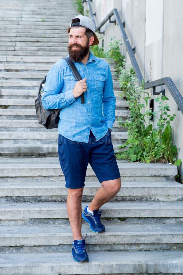 I love New York. Mature hipster with beard traveller. Bearded man. Confident brutal man walk street. Male barber care. Brutal hipster with travel backpack stock image