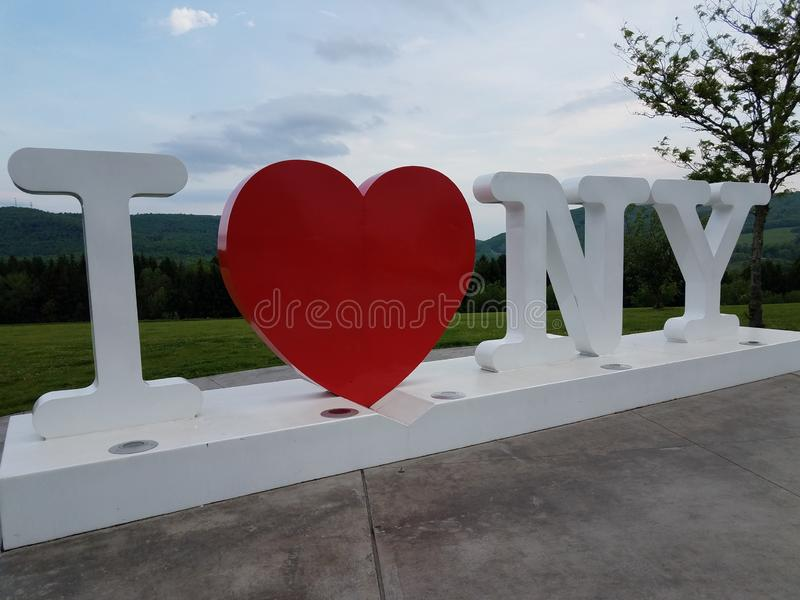 I love New York sign with red heart. And grass royalty free stock photo