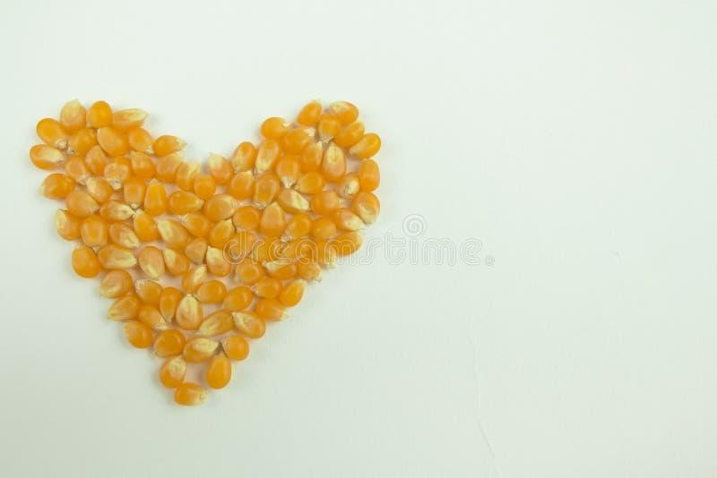 I Love Popcorn Corn Kernels in Heart Shape with Vintage Filter stock photo