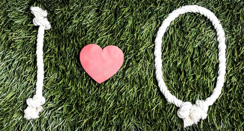 I love Q transcription made from ropes on grass background. I love Q transcription made from ropes on grass background stock images