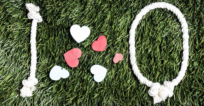 I love Q transcription made from ropes on grass background. I love Q transcription made from ropes on grass background stock photography