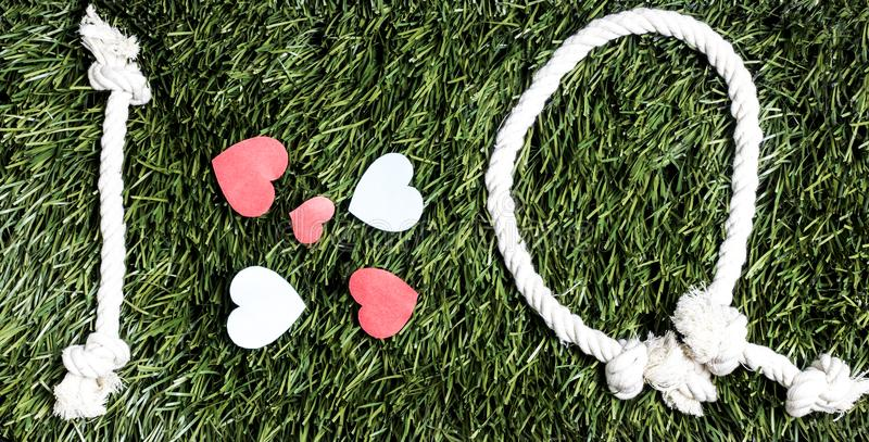I love Q transcription made from ropes on grass background. I love Q transcription made from ropes on grass background stock photos