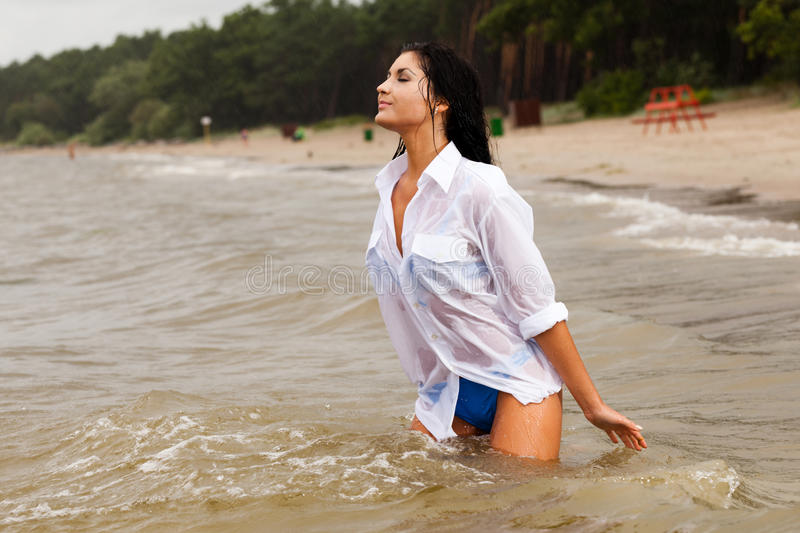 I love rain. Young lady enjoys rainy weather royalty free stock photo