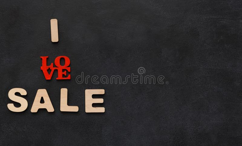 Phrase i love sales on black background with copy space royalty free stock image