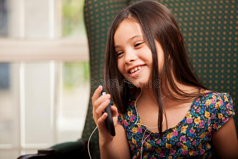 Download I love this song! stock image. Image of phone, hispanic - 34083897