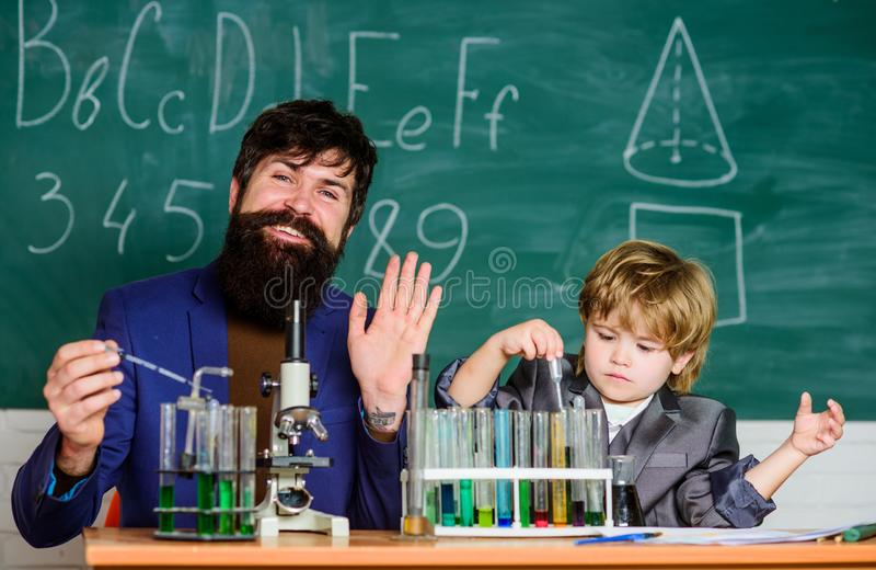 I love study in school. Study chemistry. Studying is interesting. Chemical invention. School laboratory. Teacher and royalty free stock photos