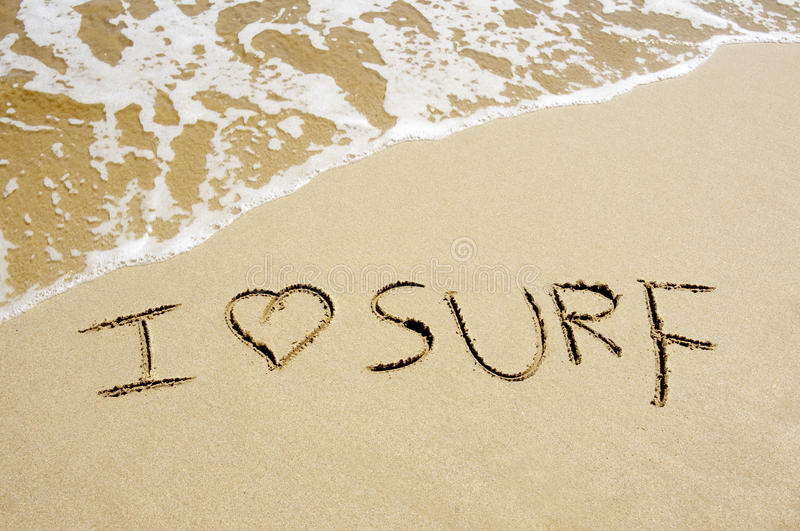 I love surf. Written on the sand of a beach royalty free stock photography