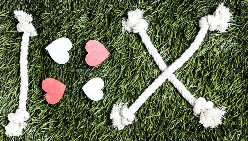 I love X transcription made from ropes on grass background. I love X transcription made from ropes on grass background stock photos