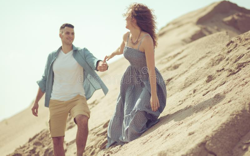 I love what you`re doing to me. Couple in desert stock image
