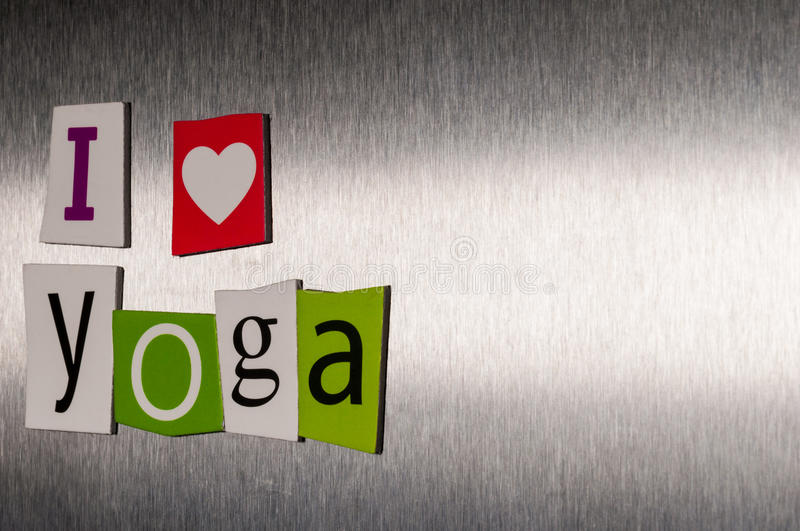 I Love Yoga written with color magazine letter clippings on metal background. Concept of sport and healthcare life.  stock photo