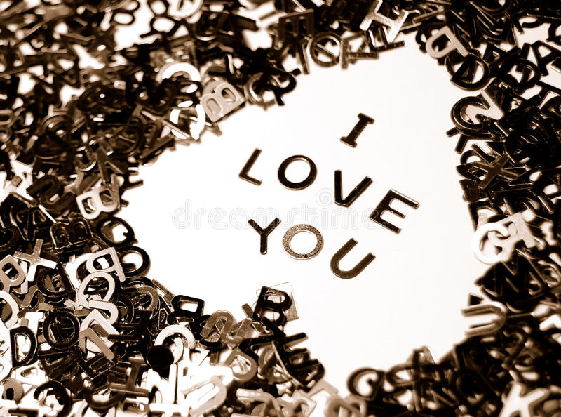 I Love You. 'I Love You' message in a heart made from miniature letters on white background (monochrome royalty free stock photo