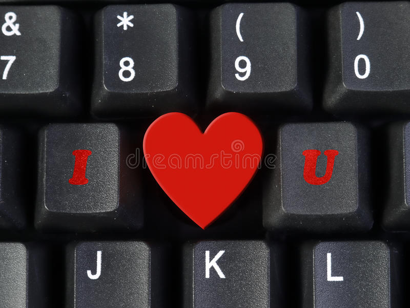 I Love You. Acronym arranged from computer keyboard keys I and U with heart shape representing Love word stock photo