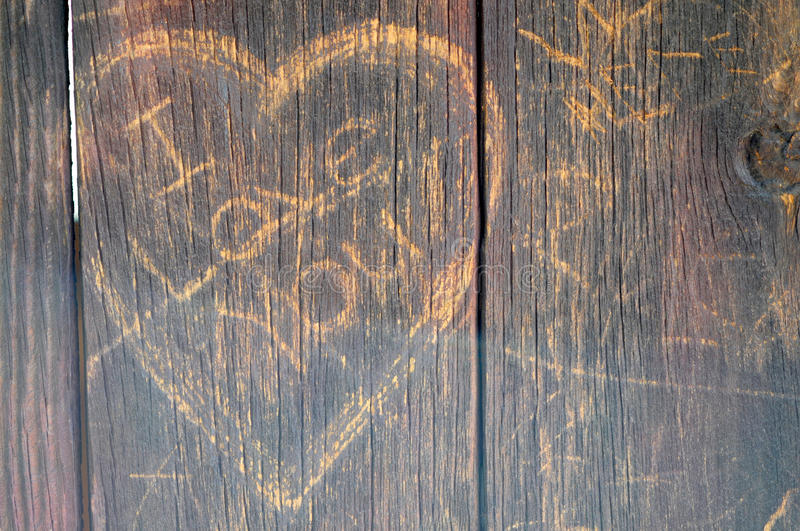 I Love You. The Words I Love You inside a heart scratched into the weathered wood siding of an old barn stock image