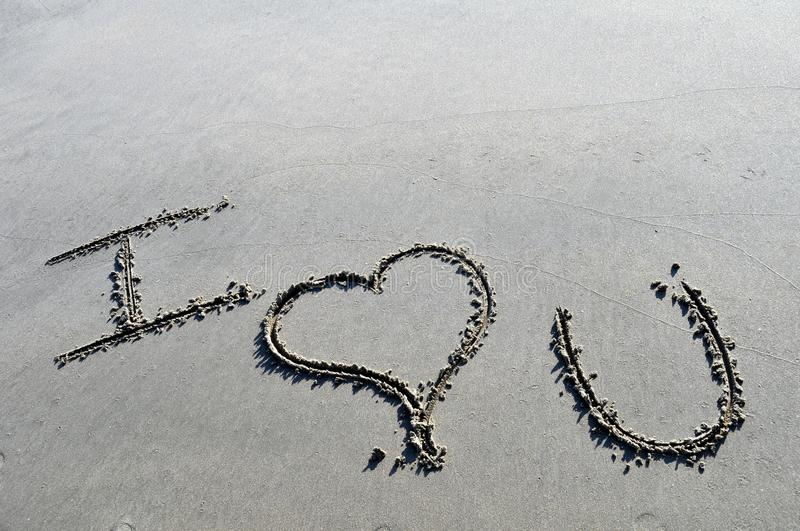 I love you. A picture of the short hand for I love you drawn in the sand royalty free stock images
