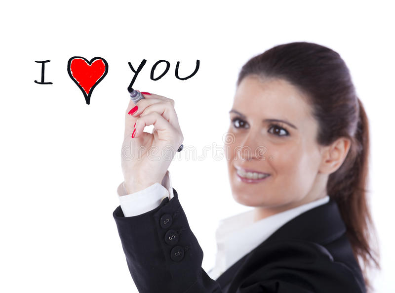 I Love You. Young happy woman writing a love message on the whiteboard (selective focus royalty free stock image