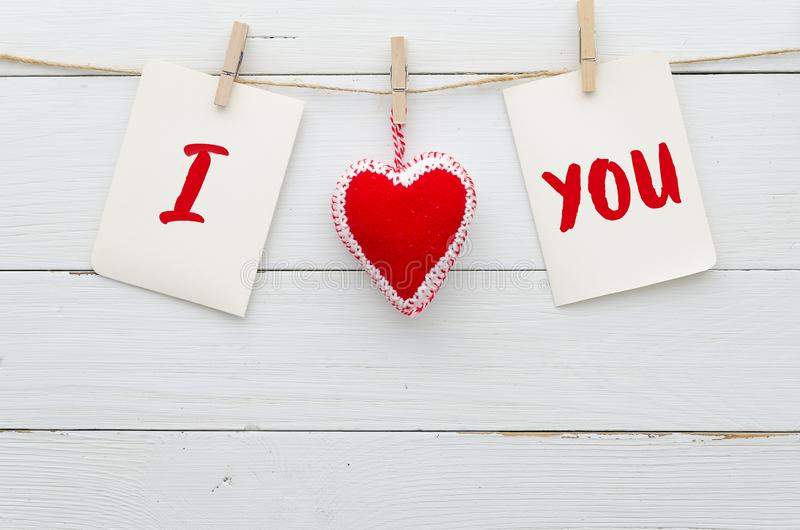 I Love You background. `I Love You`. heart and note with words `I Love You`. On white wood background. Flat lay conceps royalty free stock photography