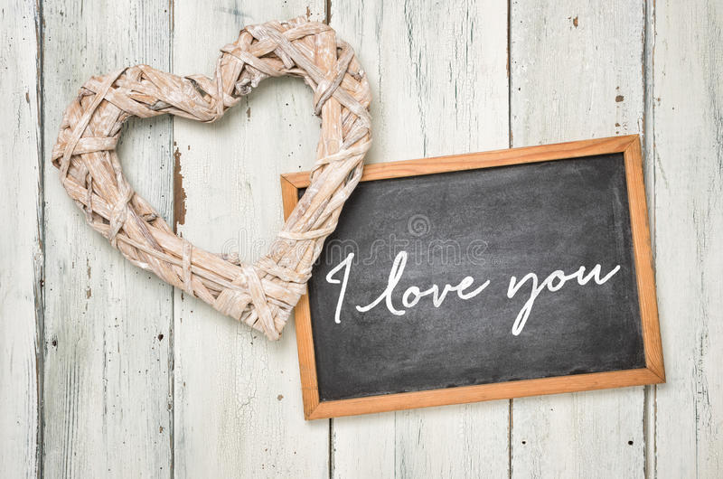 I love you. Blackboard with a braided heart - I love you royalty free stock images