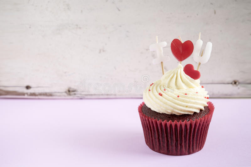 I love you cupcake. With red heart over vintage wooden background with copy space, Gift for valentine, wedding birthday and anniversary day royalty free stock photography