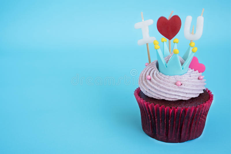 I love you cupcake. For valentine`s day and celebration birthday anniversary on blue background with copy space for text or massage stock image