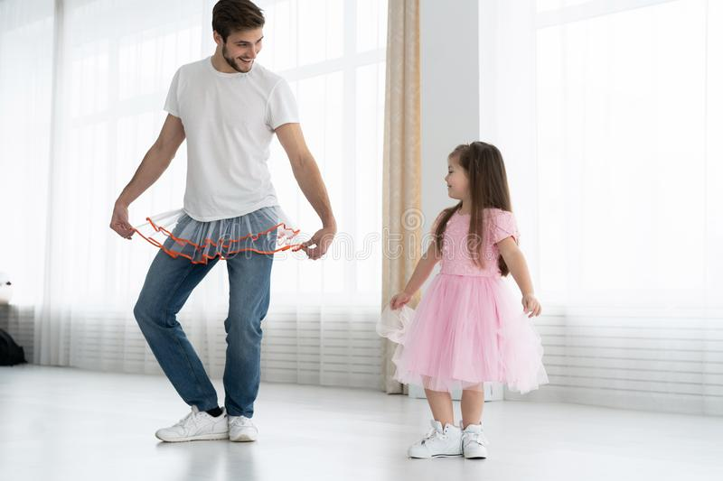 I love you, dad! Handsome young man is dancing at home with his little girl. Happy Father`s Day! royalty free stock photo