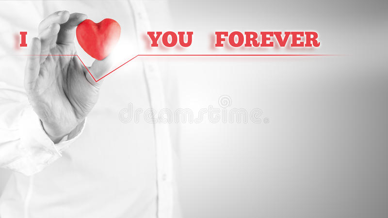 I Love You Forever. Inspirational emotional message in red on a virtual screen with a man holding a symbolic heart to represent the word love, with copyspace stock photos