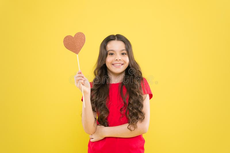 I love you. Girl little child smiling hold heart symbol on stick. Like and support. Valentines day. Fall in love. Love. Will save the world. Kid promoting love stock photos