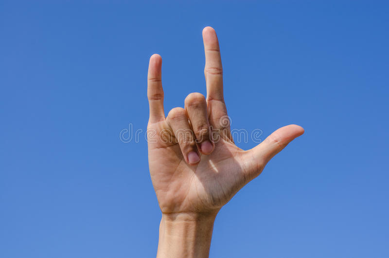 I Love You Hand Sign With Blue Sky Royalty Free Stock Photography