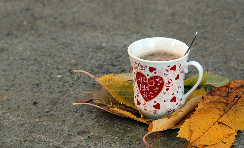 I love you , morning coffee. Picture of a I love you coffee, on one november morning with leaves stock photo