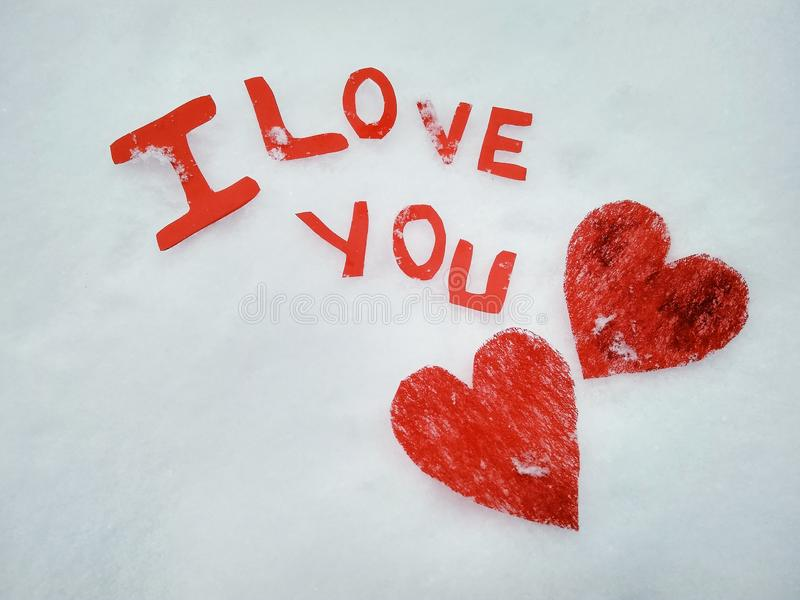 I love you peper cut words on white. I love you peper cut words with red stock photo