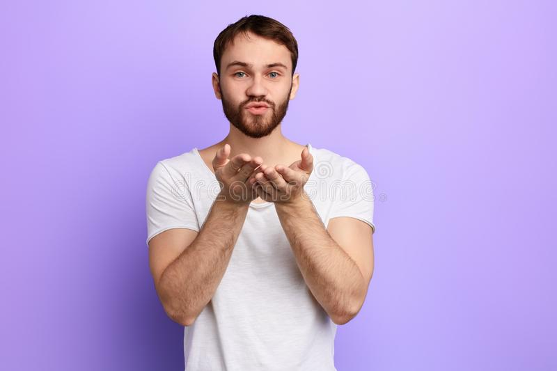 I love you. Portrait of handsome positive man blowing kiss to his lover. royalty free stock image