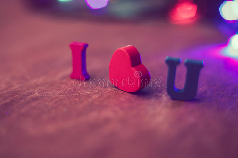 I Love You. Text with colorful light on wooden background royalty free stock photography