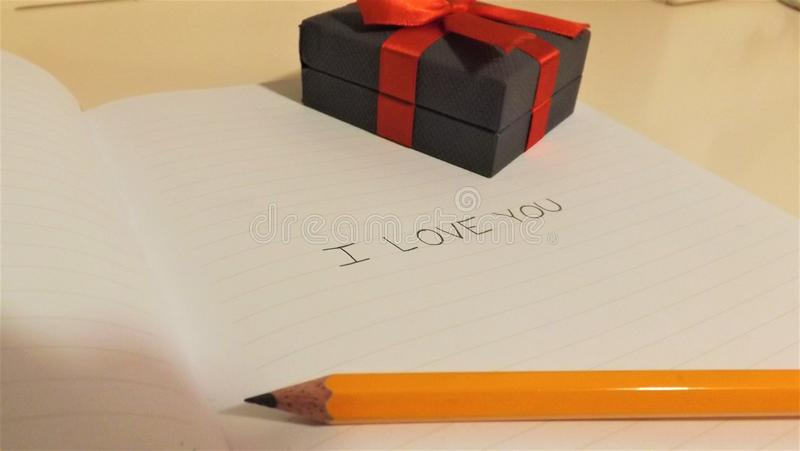 I love you on notebook with pencil and box royalty free stock photos