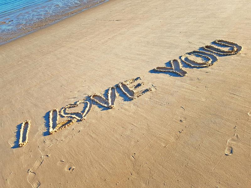 I Love You Written On The Sand Near The Seaside royalty free stock photos