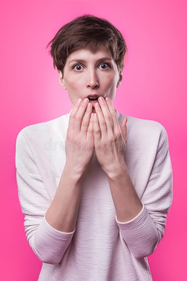 I`m afraid. Fright. Portrait of the scared woman. Business woman standing. On trendy pink studio background. Female half-length portrait. Human emotions, facial royalty free stock photos
