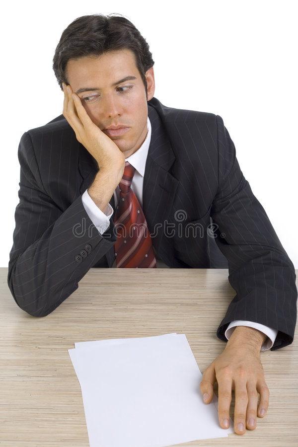 I'm boring... Bored, handsome businessman. Seating behind desk. White background, front stock photography