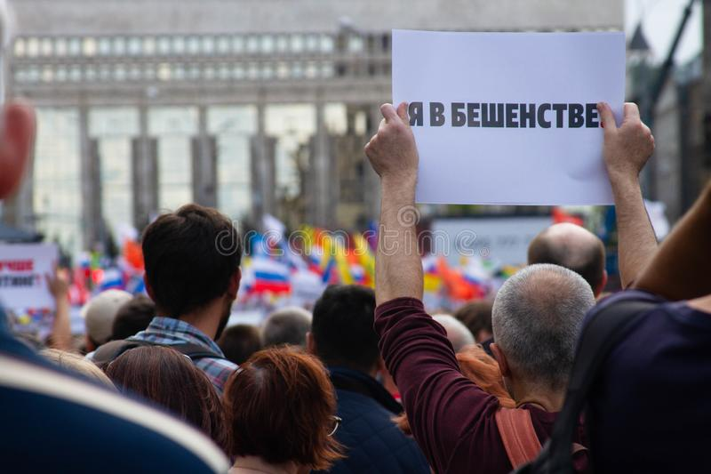I`m furious. A protester holds a poster at an opposition rally in Moscow, Russia. Moscow, Russia - July 20, 2019. I`m furious. A protester holds a poster royalty free stock photos