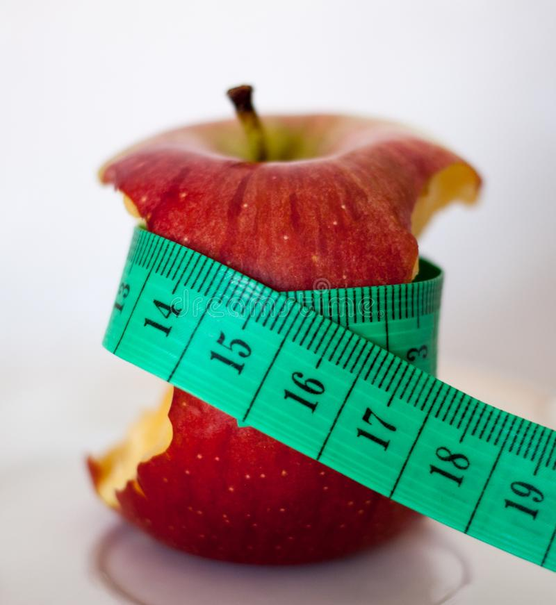 I`m going on a diet. Apple and measuring tape. royalty free stock photo