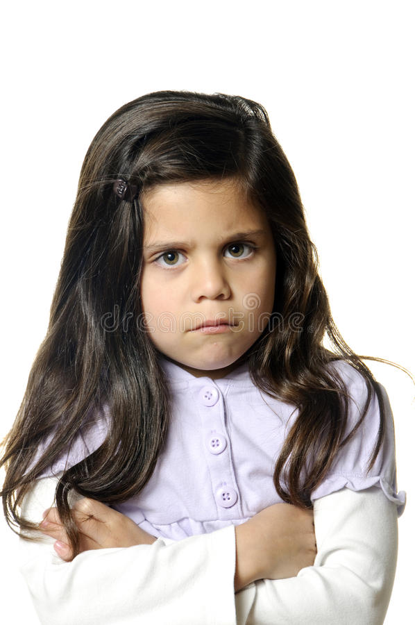 I'm mad. A six year old girl with her arms crossed showing she is mad royalty free stock photos
