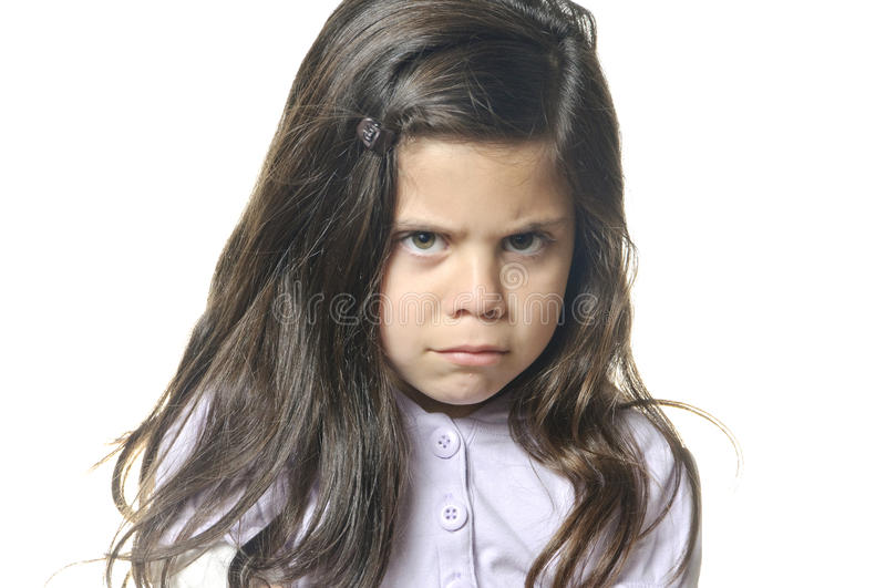 I'm mad. A six year old girl with her arms crossed showing she is mad stock photo