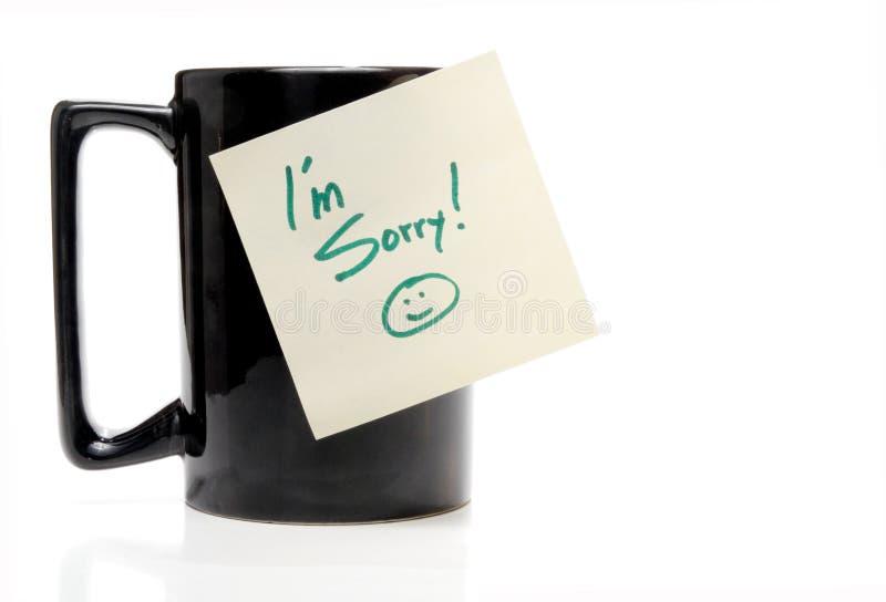 I'm Sorry. A coffee mug with an Im Sorry note stock photo